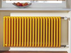 Трубчатый радиатор желтого цвета